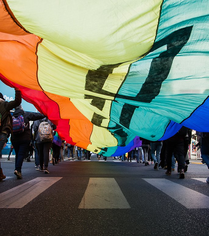 People carrying a pride flag