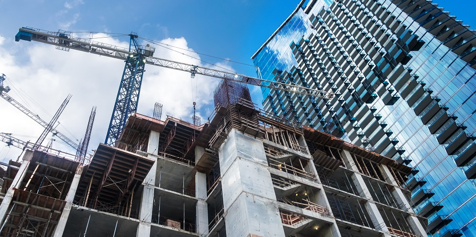 How can the construction industry reduce carbon emissions?