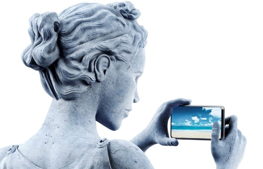 Schroders GMAI campaign navigation image of statue with smartphone